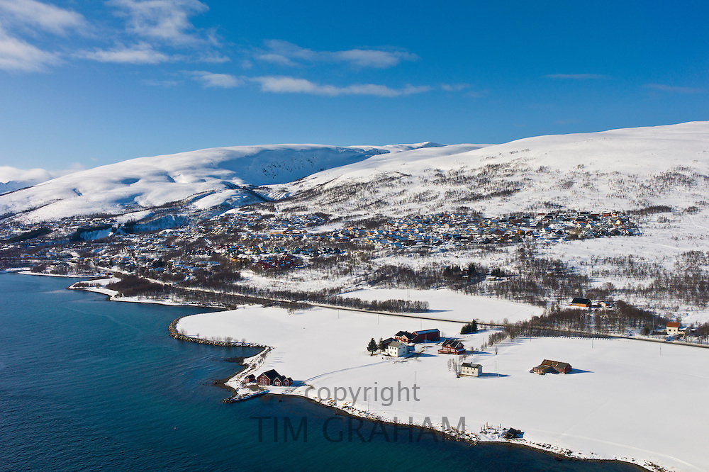 Aerial view of arctic landscape, Kvaloya Island (Whale Island) and Slettaelva Village from aircraft approaching Tromso in the Arctic Circle in Northern Norway