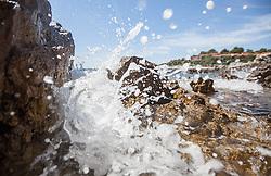 THEMENBILD - URLAUB IN KROATIEN, Wellen brechen am Steinstrand, aufgenommen am 03.07.2014 in Vrsar, Kroatien // Waves breaking on the stone beach near Vrsar, Croatia on 2014/07/03. EXPA Pictures © 2014, PhotoCredit: EXPA/ JFK