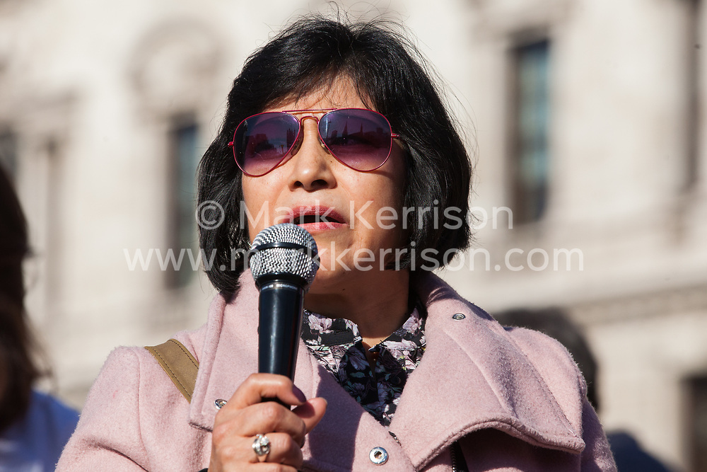 London, UK. 26th February, 2019. Independent Workers of Great Britain (IWGB) member Emma Margarita Cunalata addresses mainly migrant striking outsourced workers belonging to the IWGB, United Voices of the World (UVW) and Public and Commercial Services Union (PCS) trade unions working at the University of London (IWGB), Ministry of Justice (UVW) and Department for Business Energy and Industrial Strategy (PCS), together with representatives of the National Union of Rail, Maritime and Transport Workers (RMT) Regional Council, taking part in a 'Clean Up Outsourcing' demonstration to call for an end to the practice of outsourcing. The demonstration was organised to coincide with a significant High Court hearing of an application by the IWGB for judicial review of a decision by the Central Arbitration Committee (CAC) not to hear their application for trade union recognition for the purposes of collective bargaining with the University of London.