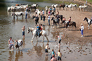 Horses and their owners on the Eden riverbed during the Appleby Fair.