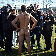 The' Nude Blacks' conduct media interviews after the 'Nude Blacks' versus a Fijian invitation side played at Logan Park, Dunedin as an unofficial curtain raiser match before the New Zealand V Fiji test match in Dunedin, New Zealand...The 'Nude Blacks' won the match 20-10 with 21 year old female player Rachel Scott, a member of the Otago women's rugby team named player of the day. .Over 500 people turned up to watch the match which included a blind referee, Julie Woods and three clothed streakers who were ejected from the playing area..The 'Nude Blacks' traditionally play games before test matches in Dunedin and were using this match as a warm up for three nude games planned during the IRB Rugby World Cup in New Zealand with teams from Argentina, Italy, England and Ireland involved.  Matches will be played before World Cup games in Dunedin. New Zealand. 22nd July 2011. Photo Tim Clayton