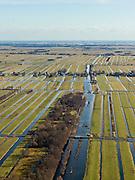 Nederland, Zuid-Holland, Gemeente Ouderkerk, 20-02-2012; Krimpenerwaard met Stolwijksche Boezem overgaand in Stolwijker vliet. De boezem is in het verleden gebruikt voor tijdelijke opvang van het polderwater. De langwerpige verkaveling is ontstaan door het ontginnen van het veen vanuit de dorpen langs de rivier de Hollandsche IJssel. Polder Kattendijksblok (voorgrond) heeft ontginningen met vrije opstreek, Polder Achterbroek (achter het gelijknamige buurtschap) is een restontginning. De sloten en de Vliet zorgen voor ontwatering. .Krimpenerwaard with Stolwijk bezel, the 'bosom' was used in the past for temporary storage of polder water. The land division (in lots) is the result of the reclamation of peat bog that started from the villages along the river Hollandsche IJssel. The ditches and brook provide drainage..luchtfoto (toeslag), aerial photo (additional fee required);.copyright foto/photo Siebe Swart.
