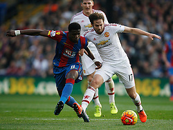 Wilfried Zaha of Crystal Palace (L) and Daley Blind of Manchester United in action  - Mandatory byline: Jack Phillips/JMP - 07966386802 - 31/10/2015 - SPORT - FOOTBALL - London - Selhurst Park Stadium - Crystal Palace v Manchester United - Barclays Premier League