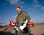 Chief of the Air Staff Sir Jock Stirrup pays visit to Red Arrows, Britain's Royal Air Force aerobatic team. Walking away from the red Hawk jet aircraft in which he has been flown in the rear seat, the VIP smiles after the exhilarating training flight. Carrying his flight helmet and wearing the full survival suit, he is here to see for himself what value for money the Red Arrows give to the UK. Their purpose is not simply to entertain summer seaside crowds but also as an RAF recruiting tool and for UK defence export advertising. Air Chief Marshal Sir Graham Eric Stirrup GCB, AFC, FRAeS, FCMI, RAF (born 4 December 1949), usually referred to as Sir Jock Stirrup, was a fast jet pilot, and is now a senior Royal Air Force commander. He was the Chief of the Air Staff  (CAS) from 2003 to 2006 and Chief of the Defence Staff.