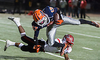 Antelope Titan's Darnell Silver (1), trips up Cosumnes Oaks Wolfpack's Jakari Jenkins (17), during the first quarter as the Cosumnes Oaks Wolfpack host the Antelope Titans, Friday, October 16, 2015.<br /> Photo Brian Baer