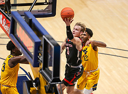 Jan 25, 2021; Morgantown, West Virginia, USA; Texas Tech Red Raiders guard Mac McClung (0) drives down the lane during the first half against the West Virginia Mountaineers at WVU Coliseum. Mandatory Credit: Ben Queen-USA TODAY Sports