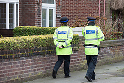 © Licensed to London News Pictures . 13/02/2014 . Manchester , UK . Police walking along Brooklawn Drive . Police at the home of Anil Khalil Raoufi (aka Abu Layth ) at 78 Brooklawn Drive in Didsbury , Manchester today (13th February 2014) . Raoufi , a British Muslim , is reported to have been killed in fighting in Syria . Photo credit : Joel Goodman/LNP