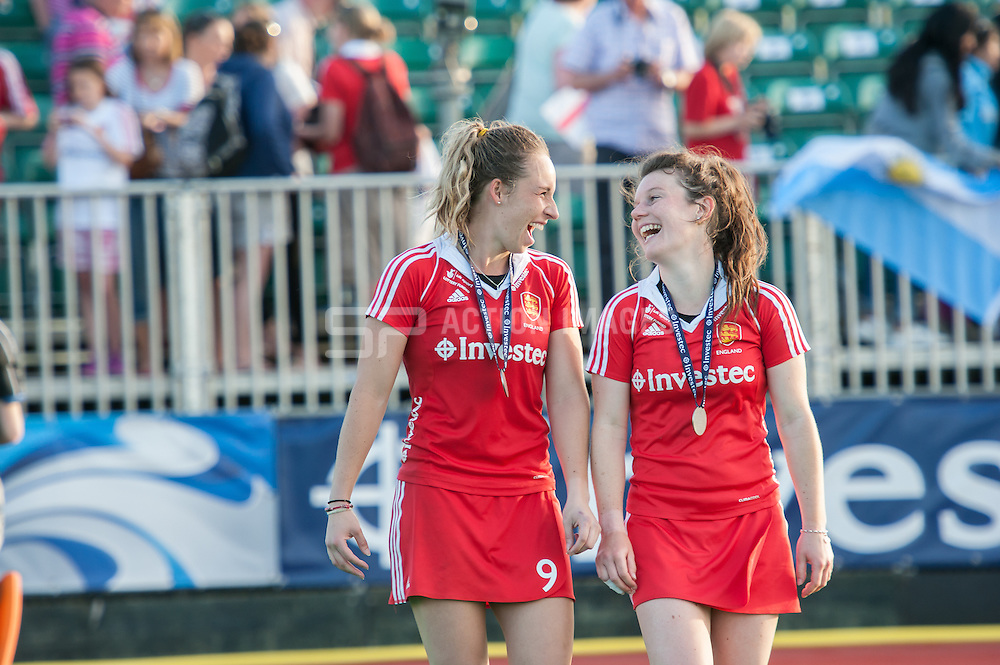 England's Laura Unsworth (right) shares a joke with teammate Susannah Townsend after the Final of the Investec Hockey World League Semi Final 2013, London, UK on 30 June 2013. Australia beat England 3-0. Photo: Simon Parker