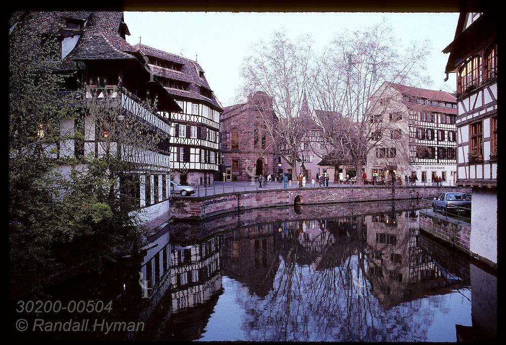 Dusk falls on buildings along canal in Quartier des Tanneurs area of Petite Francee;Strasbourg Franc