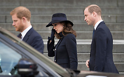 © Licensed to London News Pictures. 14/12/2017. London, UK. Prince Harry walks with The Duke and Duchess of Cambridge outside St Paul's Cathedral after attending the Grenfell Tower National Memorial Service mark the six month anniversary of the fire. The service was attended by survivors and relatives of those who lost their lives in the fire, as well as members of the emergency services and members of the Royal family. 71 people were killed when a huge fire ripped though 24-storey Grenfell Tower block in west London in June 2017. Photo credit: Peter Macdiarmid/LNP