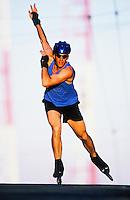 Late 20's Caucasian man inline skating.  Seattle, Wa USA<br />