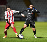 Liam Feeney of Tranmere Rovers battles for possession with Stevenage forward Jack Aitchison(27) during the EFL Sky Bet League 2 match between Stevenage and Tranmere Rovers at the Lamex Stadium, Stevenage, England on 16 January 2021.