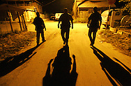 Photo by Alex Jones..US Border Patrol agents F. Hernandez, left, Joe Rosales, and O. Villarreal, right, walk through the town of Fronton after a drug seizure on May 29.  A pickup truck was carrying a load of marijuana up River Rd. from the Rio Grande when it got stuck, and the driver swam back into Mexico, said the agents.