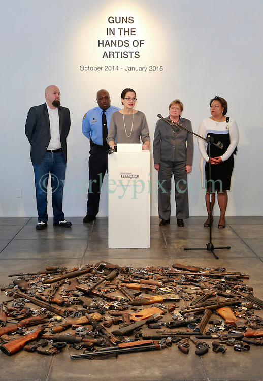 16 April 2014. Jonathan Ferrara Gallery, New Orleans, Louisiana. <br /> L/R; Jonathan Ferrara, Officer Earl Johnson and council members Stacy Head, Susan Guidry and LaToya Cantrell at the Jonathan Ferrara Gallery to announce the 'Guns In The Hands Of Artists' project where artists take parts from 190 destroyed weapons acquired by the New Orleans Police department through a buy-back program and convert them into art.  <br /> Photo; Charlie Varley/varleypix.com
