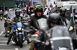 "© Licensed to London News Pictures. 12/04/2019. London, UK. Thousands of bikers make their way through Kensington in West London to take part in a protest against the prosecution of a former British soldier charged over Bloody Sunday.  The ride-out is being staged in support of ""Soldier F"", a 77-year-old Army veteran who faces charges of murder after killing two civil rights demonstrators in Londonderry, Northern Ireland, in 1972. Photo credit: Ben Cawthra/LNP"