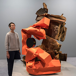 "© Licensed to London News Pictures. 07/06/2018. LONDON, UK. American artist Carol Bove poses with ""Turtle"", 2018, at the preview of an exhibition of her steel sculptures at the David Zwirner gallery in Mayfair.  The show runs 8 June to 3 August 2018.  Photo credit: Stephen Chung/LNP"