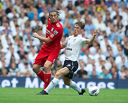 18.09.2011, White Hart Lane, London, ENG, PL, Tottenham Hotspur FC vs Liverpool FC, im Bild Liverpool's Andy Carroll in action against Tottenham Hotspur's Scott Parker during the Premiership match at White Hart Lane. EXPA Pictures © 2011, PhotoCredit: EXPA/ Propaganda Photo/ David Rawcliff +++++ ATTENTION - OUT OF ENGLAND/GBR+++++