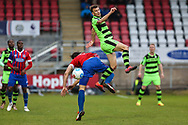 Forest Green Rovers Christian Doidge(9) wins a header against Dagenham's Craig Robson(5) during the Vanarama National League first leg play off match between Dagenham and Redbridge and Forest Green Rovers at the London Borough of Barking and Dagenham Stadium, London, England on 4 May 2017. Photo by Shane Healey.