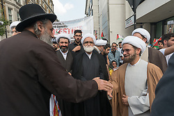 June 18, 2017 - London, UK - London, UK. 18th June 2017. The annual Al Quds (Jerusalem) Day march in London was attended by several thousand from all over the country. Organised by Quds committee with the Islamic Human Rights Commission and supported by various groups including the Stop the War Coalition, Muslim Association of Britain and Jews for Boycotting Israeli Goods was led by Imams and Neturei Karta anti-Zionist Jews, it called for Freedom for Palestine and for all oppressed people's across the world. As usual in attracted opposition from Zionist groups, with a rally being held close to the US Embassy where the march was to end with its own rally. There were protests along the route by a small group carrying Israeli flags who claim the event supports terrorism by carrying Hezbollah flags. The marchers reminded them that Israel was founded in terrorism and still is in breach of international law in its opression of the Palestinian people. Peter Marshall ImagesLive (Credit Image: © Peter Marshall/ImagesLive via ZUMA Wire)
