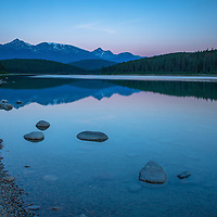 A serene dawn slowly reveals itself at Patricia Lake in Jasper National Park, Canada.