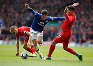 Ross Barkley of Everton tussles with Roberto Firmino of Liverpool during the English Premier League match at Anfield Stadium, Liverpool. Picture date: April 1st 2017. Pic credit should read: Simon Bellis/Sportimage