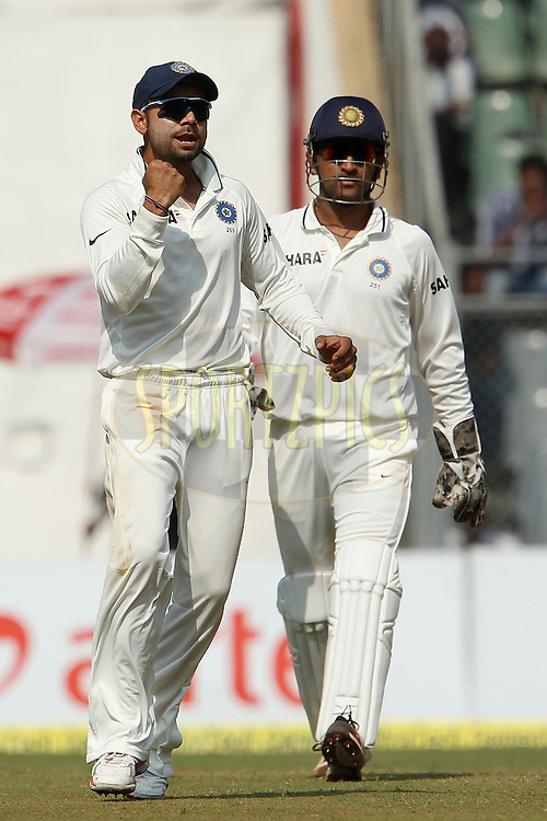 Virat Kohli of India and Mahendra Singh Dhoni - Captain of India celebrate the wicket of Nick Compton of England during day 2 of the 2nd Airtel Test match between India and England held at the Wankhede Stadium in Mumbai, India on the 24th November 2012...Photo by Ron Gaunt/ BCCI/ SPORTZPICS..Use of this image is subject to the terms and conditions as outlined by the BCCI. These terms can be found by following this link:..http://www.sportzpics.co.za/image/I0000SoRagM2cIEc