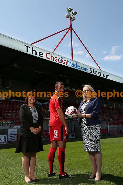 Crawley Town's Simon Walton with sponsors from Homes Partnership at the Checkatrade.com Stadium.<br /> James Boardman / TELEPHOTO IMAGES 07967642437