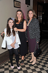 Left to right, ALLEGRA HARRIS, VASSI CHAMBERLAIN and ELSA CHAMBERLAIN at a fashion show by Catherine Walker & Co in support of The Haven held at One Mayfair, North Audley Street, London on 18th May 2011.