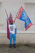 A man with English flags, wearing a visit Kuwait t-shirt, outside the Houses of Parliament the day after Theresa Mays crushing defeat over her Brexit deal on the 16th January 2019 in London in the United Kingdom. Prime Minister Theresa May is expected to win a confidence vote on the 16th, despite a crushing defeat over her Brexit deal.