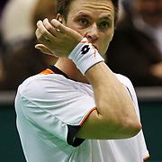 NLD/Rotterdam/20100214 - ABN - AMRO tennistoernooi 2010, finale Michail Joezjni (yellow racket)- Robin Söderling (white/orange shirt)