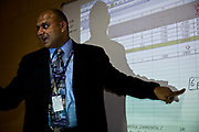 Bejoy George in an IT presentational meeting with colleagues and clients at Bangalore IT consultancy office, India.