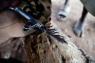 A vulture feather in the AK-47 of a Jie warrior that shows he has killed a man with his gun in Jonglei state, Southern Sudan.