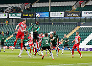 Plymouth Argyle midfielder Tyrese Fornah (18) and Sunderland Forward Ross Stewart (31) battles in the air  during the EFL Sky Bet League 1 match between Plymouth Argyle and Sunderland at Home Park, Plymouth, England on 1 May 2021.