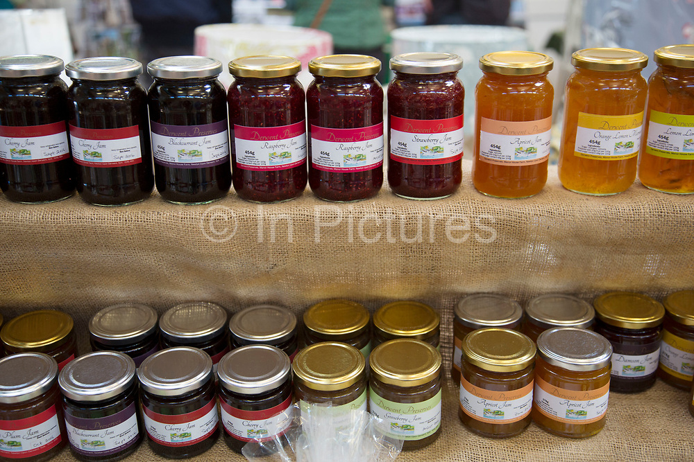 Local community Sunday market in the village of Husthwaite, North Yorkshire, England, UK. Over 20 stalls with a mixture of old favourites and new stalls lelling locally made products, like these jams and preserves.