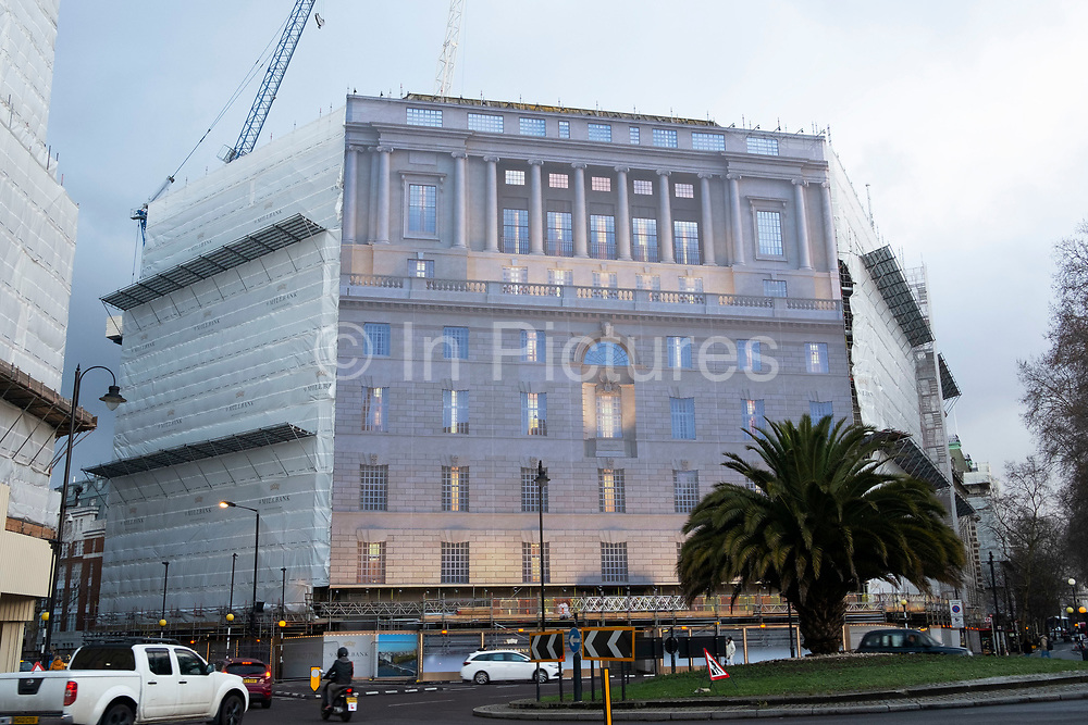 Building under refurbishment, is wrapped in a fake classical facade to make it look tidy during the process, London, United Kingdom.