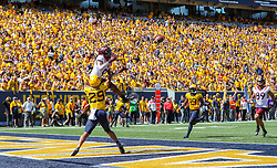 Sep 18, 2021; Morgantown, West Virginia, USA; Virginia Tech Hokies wide receiver Tayvion Robinson (9) catches a pass over West Virginia Mountaineers safety Sean Mahone (29) for a touchdown during the first quarter at Mountaineer Field at Milan Puskar Stadium. Mandatory Credit: Ben Queen-USA TODAY Sports
