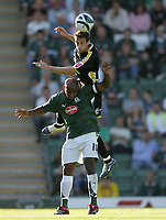 Photo: Lee Earle.<br /> Plymouth Argyle v Cardiff City. Coca Cola Championship. 15/09/2007.Cardiff's Roger Johnson (b) out-jumps Barry Hayles.