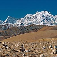 Himalaya, Tibet, China. Cairns left by Tibetan Buddhist travelers on 17,000' Lalung Leh pass near Mount Xixabangma.