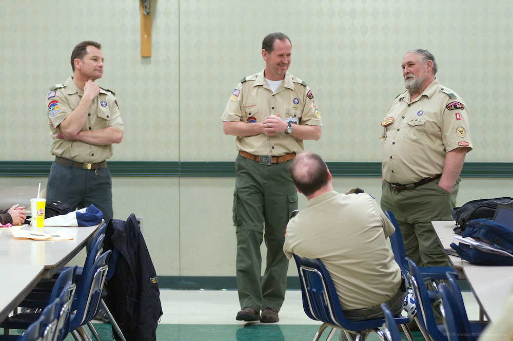 Scout leaders Barry Esslinger, left, Jack Boles, Glenn Herre and Phil Barber talk while the boys conduct a merit badge class. A regular Monday, March 1, 2010 meeting of Boy Scout Troop 4 at St. Agnes Catholic Church on Newburg Road. (Photo by Brian Bohannon)