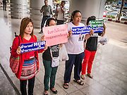 "23 JANUARY 2013 - BANGKOK, THAILAND:   Supporters of convicted magazine editor Somyot Prueksakasemsuk picket the front of Bangkok Criminal Court after Somyot's sentencing. Somyot was sentenced to 11 years imprisonment on ""Lese Majeste"" charges Wednesday. He was arrested on April 30, 2011, and charged under article 112 of Thailand's penal code, which states that ""whoever defames, insults or threatens the King, the Queen, the Heir-apparent or the Regent, shall be punished with imprisonment of three to fifteen years"" after the magazine he edited, ""Red Power"" (later changed to ""The Voice of Thaksin"") published two articles by Jit Pollachan, the pseudonym of Jakrapob Penkair, the exiled former spokesman of exiled fugitive former Prime Minister Thaksin Shinawatra. Jakrapob, now living in Cambodia, has never been charged with any crime for what he wrote.     PHOTO BY JACK KURTZ"