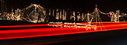 Car taillights cause streaks during a long time exposure as they drive through the Way of Lights holiday light display at the National Shrine of Our Lady of the Snows in Belleville on December 3, 2019. This is the 50th anniversary of the annual light display, which runs from 5 pm to 9 pm through December 31.<br />Photo by Tim Vizer