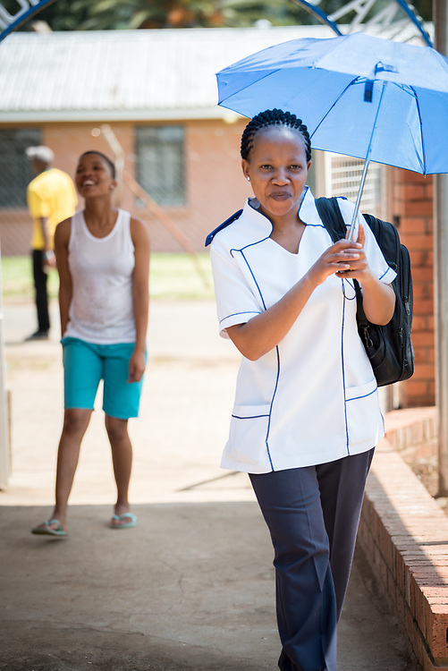 2 March 2017, Ma Mafefooane Valley, Lesotho: A former student, now nurse at Saint Joseph's Hospital, enters the Roma College of Nursing. The Roma College of Nursing is a Roman Catholic non-profic institution under the Christian Health Association of Lesotho. The college educates nurses and midwives, and is situated adjacent to Saint Joseph's Hospital in the Ha Mafefooane Valley, some 35 kilometers from Lesotho's capital, Maseru. The school forms an integral part of Saint Joseph's Hospital, where the students acquire essential parts of their hands-on training. The school was founded in 1972, and is open to candidates of any gender and various religious backgrounds. Applications are also open to students from other countries. Most students begin their studies at the age of 19-20. Most are from Lesotho, but some are international. The college hosts a total of some 120 students. Four out of five are women. Through sponsorship from ICAP and the Nursing Education Partnership Initiative (NEPI), which draws funds from PEPFAR, the school maintains a library and a skills laboratory specifically designed to improve nursing education in Lesotho. There are six nursing training institutions in Lesotho in total, of which four are denominational as part of the Christian Health Association of Lesotho, and thus owned by the churches. Two institutions are public, run by the government.