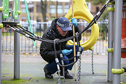 © Licensed to London News Pictures. 12/10/2020. London, UK. Police search team carry out a search in a children's playground within the crime scene in Homerton in Hackney, north London following a triple shooting. Officers were called at 22:48hrs on Sunday, 11 October, to reports of a shooting on Homerton High Road in Hackney, and found three people with gunshot injuries. Two men, aged 60 and 32, were taken to hospital with non life-threatening/life-changing injuries. A third man, aged 24, was taken to hospital and remains in a life-threatening condition. Photo credit: Dinendra Haria/LNP