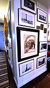 """Dollar store picture frames and prints of famous French landmarks adorn this wall. Photo taken on January 8, 2019 for """"At Home"""" feature on Sandy Stolberg, who uses dollar store finds as part of the decorations in her Belleville, IL condo.<br /> Photo by Tim Vizer"""