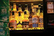 Bottles of Irish whiskey on display inside pub, city of Dublin, Ireland, Irish Republic
