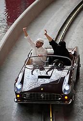 Visitors in traditional Islamic dress on ride at Ferrari World in Abu Dhabi United Arab Emirates UAE