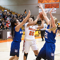 Gallup's Kamryn Yazzie (20) drives to the basket in Friday night's game against Bloomfield at Gallup High School.