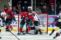 KELOWNA, CANADA - MARCH 16:  Mark Liwiski #9 of the Kelowna Rockets is checked by Joel Sexsmith #47 of the Vancouver Giants during third period on March 16, 2019 at Prospera Place in Kelowna, British Columbia, Canada.  (Photo by Marissa Baecker/Shoot the Breeze)