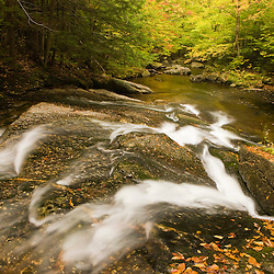 A stream in fall in a forest in Grafton, New Hampshire.