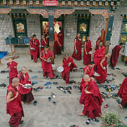 Young monks at the Punakha monastery.<br /> Monks leaving the dining hall after diner.